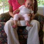 under-thigh hold on potty between thighs