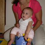 older baby on toilet seat insert